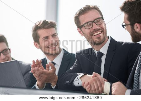 close-up handshake of business people at a working meeting.