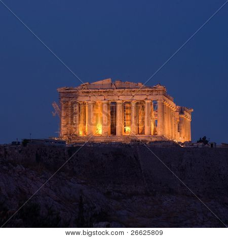 view from Filopappos-Philopappos hill of Parthenon by night in the city of Athens