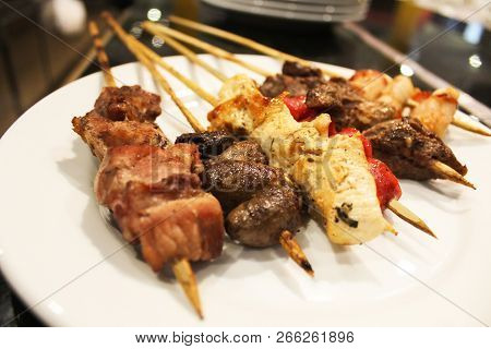 Barbecue Meat. Grilled Meats Skewers On Plate.