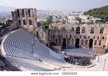 Ancient theatre of Herodes Atticus  is a small building of ancient Greece used for public performances of music and poetry, below on the Acropolis and in background dwelling of metropolis Athens