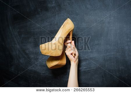 Female Hand Holding High Heels Shoe, Stock Photo Image