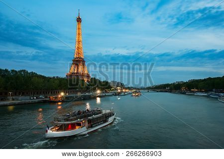 Paris, Fracne - May 08,2016 : Seine River Night View With Eiffel Tower In Paris, France. Paris Is Th