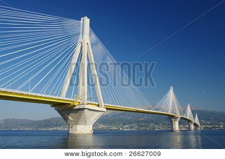 suspension bridge crossing Corinth Gulf strait, Greece. Is the world's second longest cable-stayed bridge poster