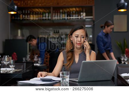 Smiling Elegant Business Lady Talking On Phone And Reading E-mails On Laptop Screen
