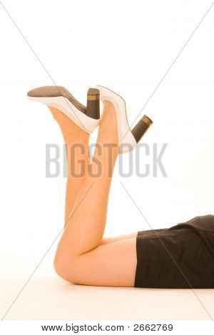 Woman Legs With White Shoes