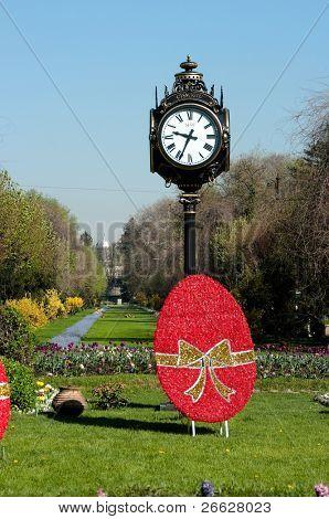 public clock and decorative easter egg in the Cismigiu Park, in center of Bucharest, Romania