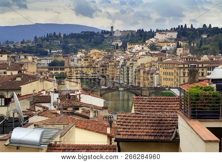 View Of Florence (firenze), With The Ponte Vecchio And The River Arno, Italy.