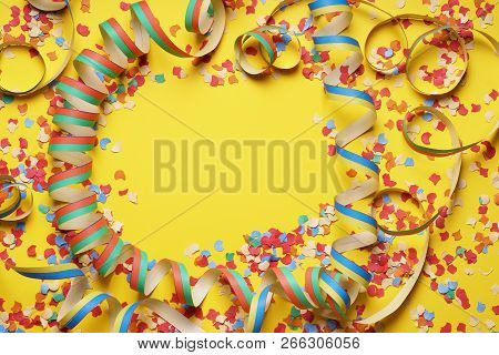 Confetti And Paper Streamer Frame On Yellow Background - Party Celebration Concept Flat Lay With Cop