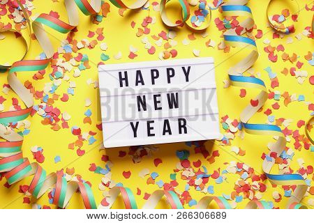 Happy New Year Party Celebration Flat Lay With Confetti And Streamers On Yellow Background