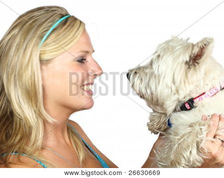 Beautiful blond girl holding west highland terrier on white background poster