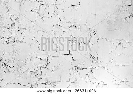 The Texture Of The Stone Concrete Old Shabby Wall With Cracks And Chips With Whitewashing And Exfoli
