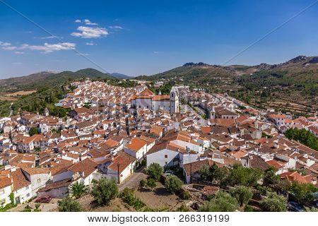 Panorama of Castelo de Vide, with rooftops and landscape. Santa Maria da Devesa Church and Dom Pedro Square seen from Castle Tower. Castelo de Vide, Alto Alentejo, Portugal