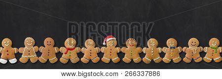 Many Cute Gingerbread Men On A Blackboard