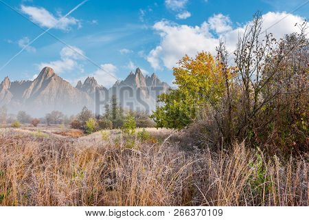 Late Autumn Frosty Day Composite Image. Tall Grass And Trees In Fall Foliage. Mountains With High Pe