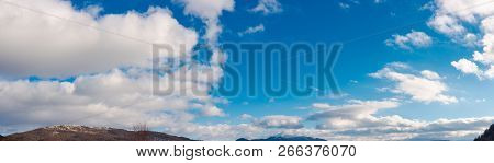 Panorama Of Wonderful Winter Sky With Fluffy Clouds Above The Ridge. Beautiful Nature Background, Us