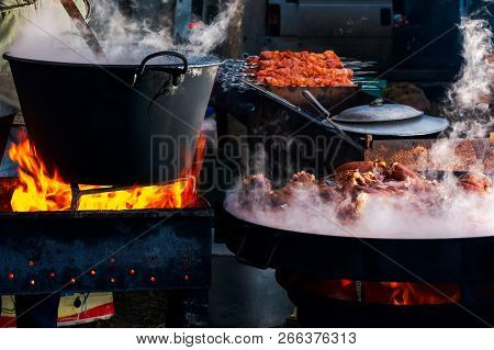 Hecha, Ukraine - Jan 27, 2018: Pork Butchers Competition. Boiling Cauldron On Fire. Meat Cooking On