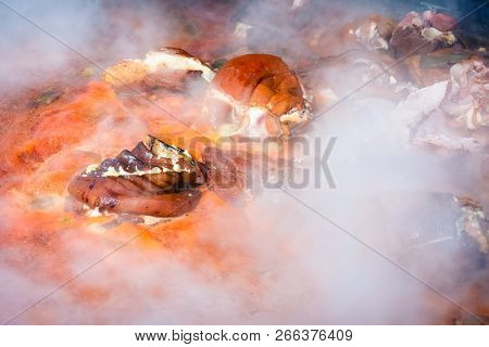 Hecha, Ukraine - Jan 27, 2018: Pork Butchers Comзetition. Traditional Knuckle In Boiling And Steamin