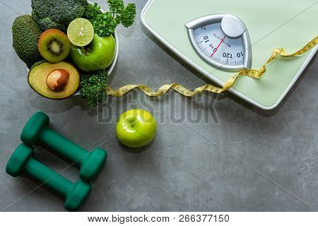 Diet And Healthy Life Concept. Green Apple And Weight Scale Measure Tap With Fresh Vegetable And Spo