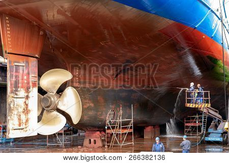 Rotterdam, Netherlands - Sep 5, 2015: Dock Workers At Work On A Vessel Hull In A Ship Repair Drydock