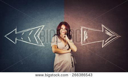 Doubtful Woman Hand Under Chin Over A Split Blackboard With Arrows Going In Two Different Ways Red A