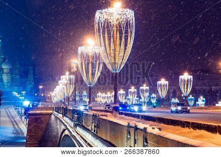 Night Winter Moscow In The Snow. Big Moskvoretsky Bridge Across The Moscow River Decorated For The N
