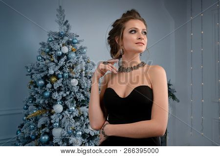 Beautiful Woman Showing Off Her Jewelery In Fashion Concept Wearing Accessories And Jewelry Over New