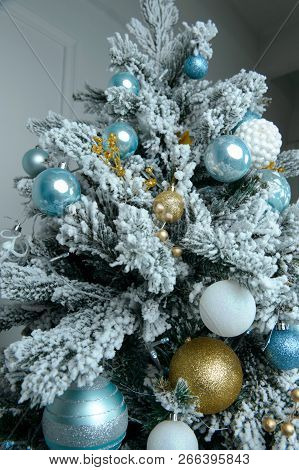 Christmas Tree Decorated With Yellow And White Balls And Tinsel. Christmas Card