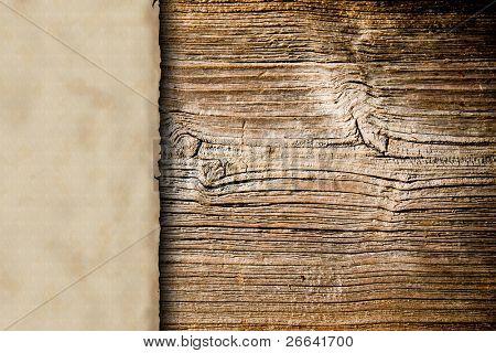 Grunge blank paper on wooden background