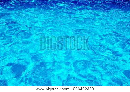 A Blue Water Background In Swimming Pool