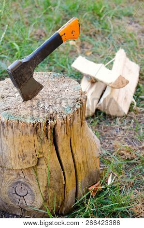 An Old Ax In A Wooden Stump