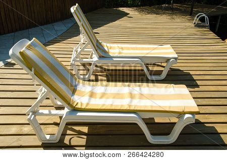 A Chaise-longues In A Hotel Near Pool