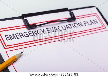 Emergency Evacuation Plan. Close Up. Macro Photography. Object