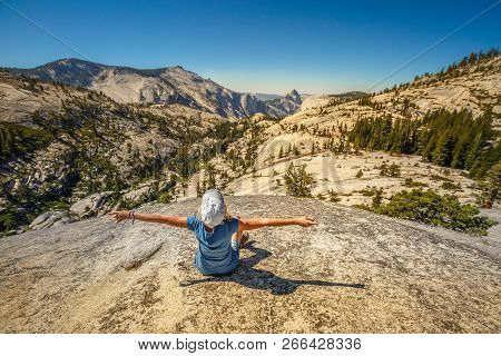 Hiking Enthusiastic Woman Relaxing At Olmsted Point And Looking The North Side Half Dome. Tired Hike