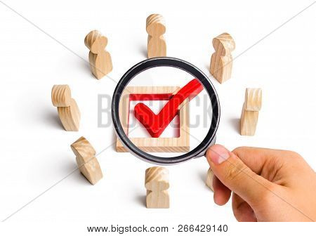 People stand in a circle and look at the check mark in the box. election, poll or referendum. Voters participate in elections of parliament or president. Decision making. Poll people. Selective focus poster