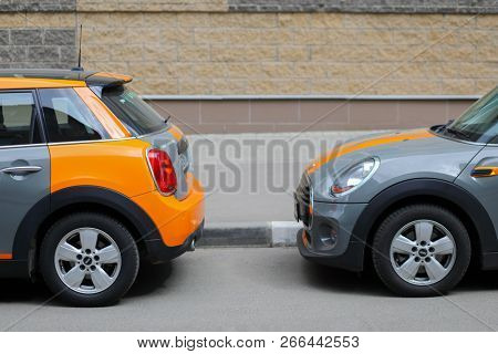 MOSCOW - APR 29, 2018: Two grey BMW mini cars of Moscow carsharing company You drive are on street, carsharing is system of short-term car rental with per minute payment