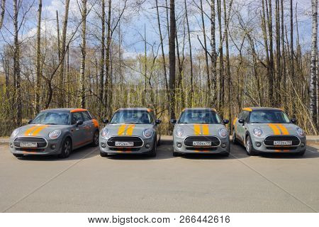 MOSCOW - APR 29, 2018: Four grey BMW mini cars of Moscow carsharing company You drive in park, carsharing is system of short-term car rental with per minute payment