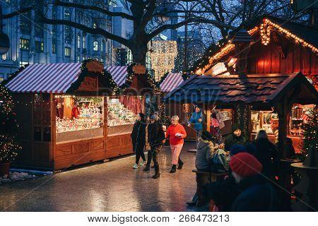 Berlin, December 25, 2017: Christmas Market In Berlin In The Evening. People Choose Christmas Gifts.