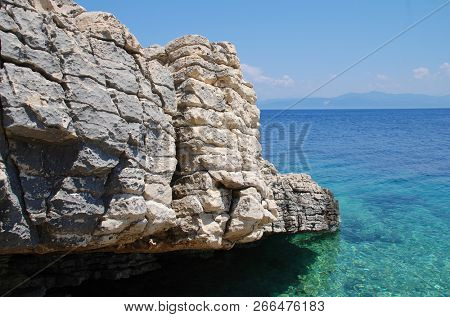 The rocky coastline of Levrechio beach at Loggos on the Greek island of Paxos.
