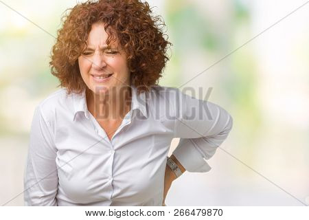 Beautiful middle ager senior businees woman over isolated background Suffering of backache, touching back with hand, muscular pain