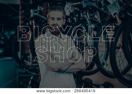 Bicycle Shop. Salesman Posing Near Bicycles. Young Beard Man. Hipster Man With Crossed Arms. Man Loo