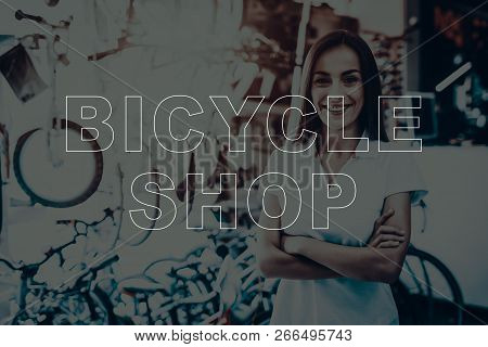 Bicycle Shop. Salesman Posing Near Bicycles. Young Beautiful Woman. Woman Looking In To Camera. Woma