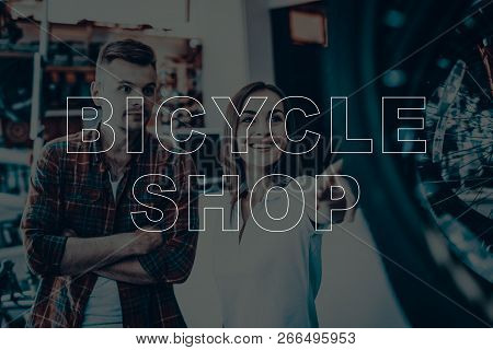 Bicycle Shop. Salesman Showing Bicycle To Customer. Woman Looking On The Bike. Woman Smiling. Custom