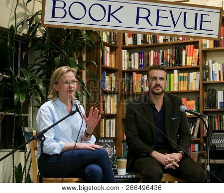 HUNTINGTON, NY - OCT 30: Actor Jason Segel (R) and co-author Kirsten Miller speak to fans before signing copies of