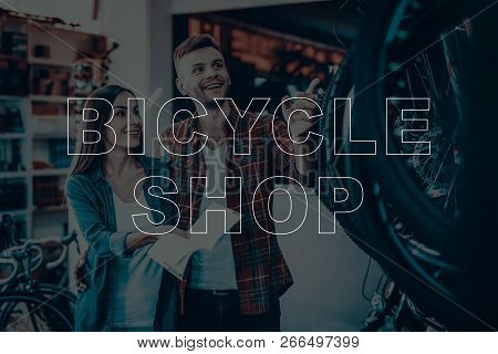 Bicycle Shop. Customers Choosing A Bicycle For Himself. Customers Is Couple Of Man And Woman. Woman
