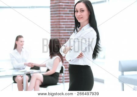 In Full Growth. Confident Business Woman On Blurred Office Background