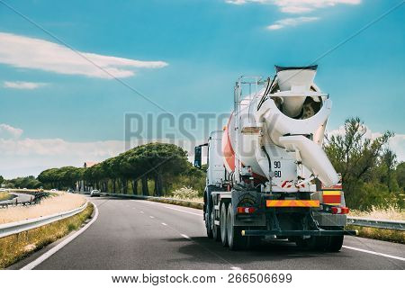 Special Concrete Transport Truck In-transit Mixer Unit In Motion On Country Road, Freeway. Freeway M