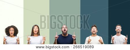 Collage of group of young people over colorful isolated background amazed and surprised looking up and pointing with fingers and raised arms.