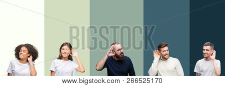 Collage of group of young people over colorful isolated background smiling with hand over ear listening an hearing to rumor or gossip. Deafness concept.