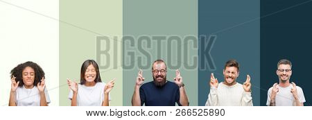 Collage of group of young people over colorful isolated background smiling crossing fingers with hope and eyes closed. Luck and superstitious concept.