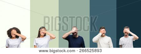 Collage of group of young people over colorful isolated background smiling and laughing with hand on face covering eyes for surprise. Blind concept.